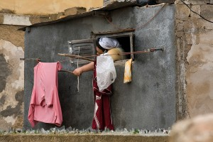 KA_1756: Morocco - Woman hanging clothes in Essaouira