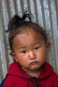 NE_0549: Nepal - Child with fly