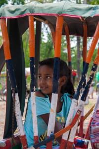 NE_0745: Nepal - Young girl in a risciò